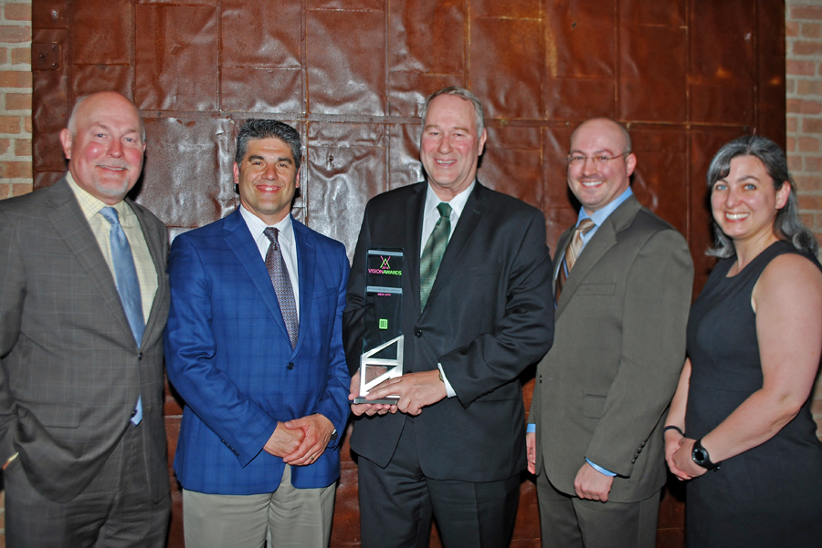 """The NEWCITY LLC team accepts the Vision Award in the category of """"Mixed-Use Development"""" at Urban Land Institute Chicago's Vision Awards in early June."""