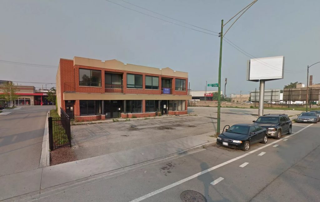 The existing site -- a closed Kinkos store (Google Street View)